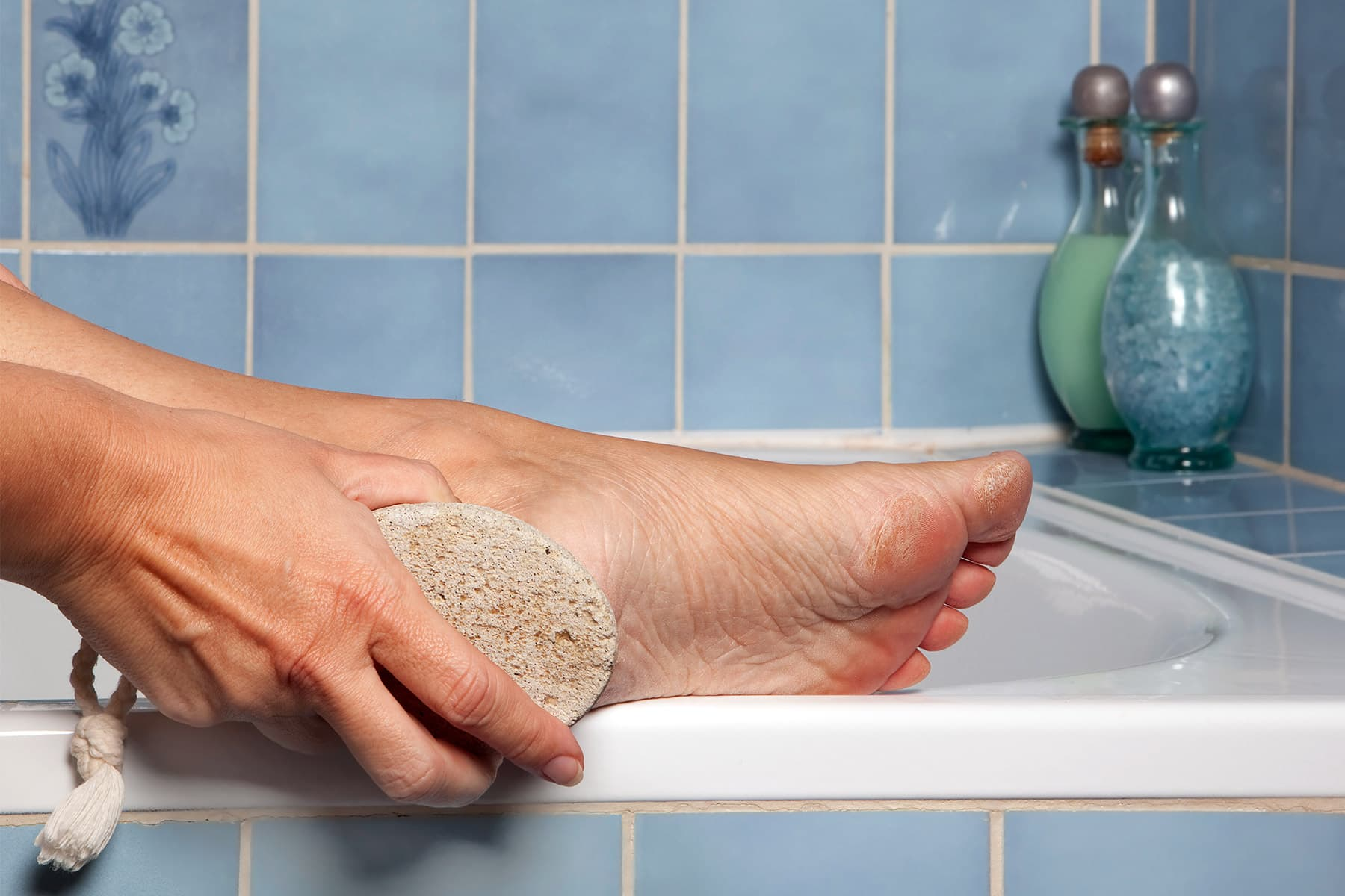 photo of using pumice stone on foot