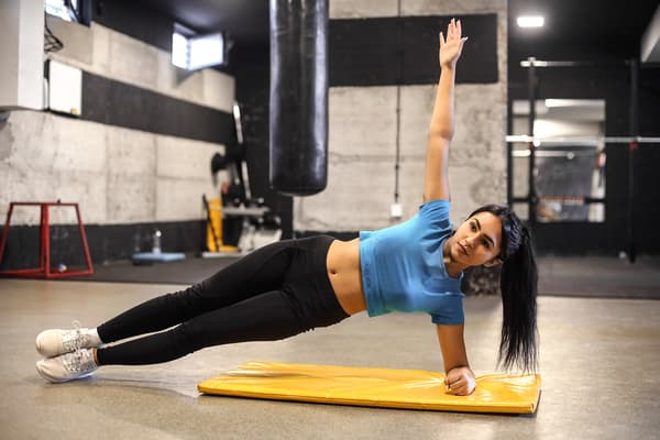 photo of woman doing side plank