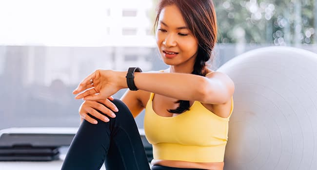 photo of woman looking at smart watch