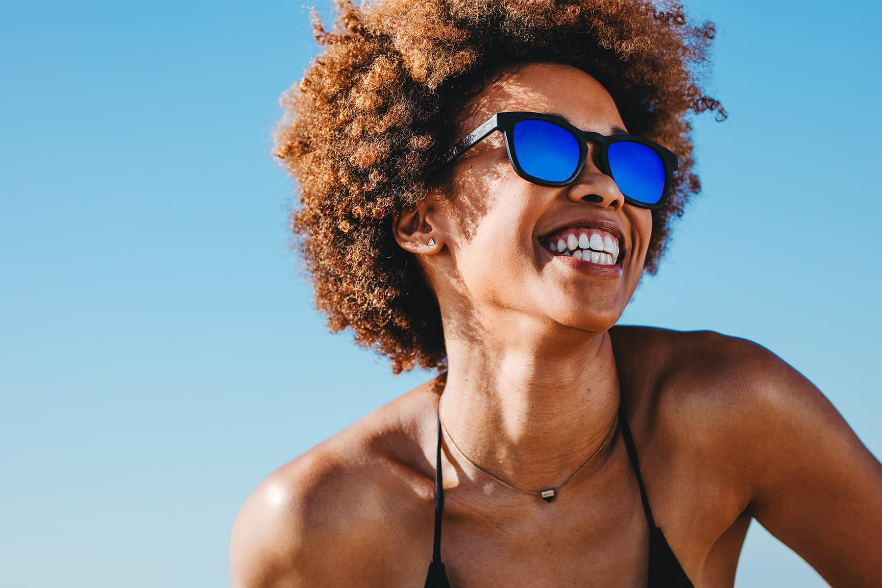 photo of woman in sunglasses