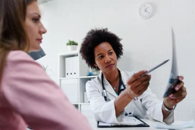 photo of female doctor looking at test results