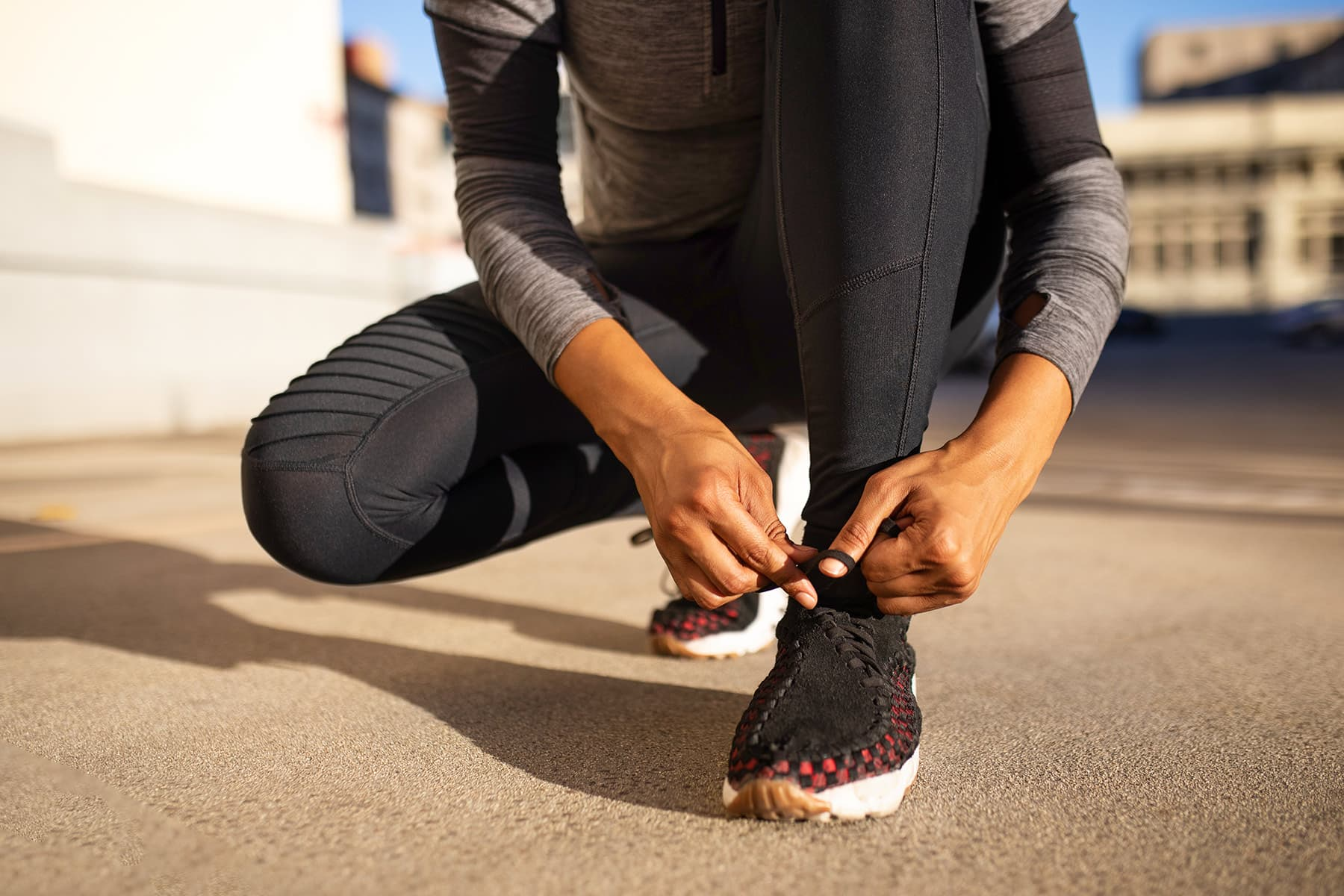 woman tying running shoes