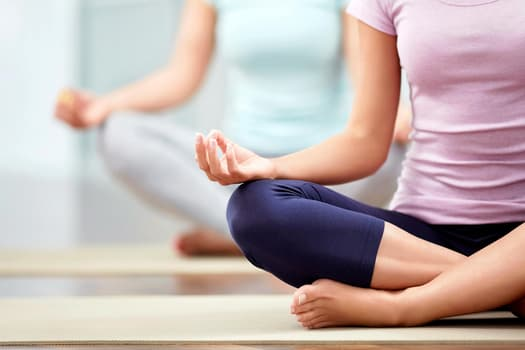 photo of lotus position in yoga class