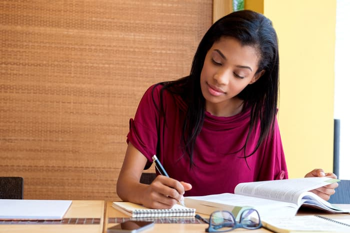 photo of young woman studying