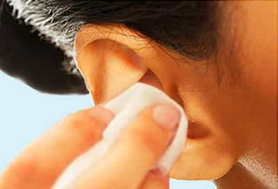 woman cleaning ear