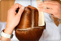 hairstylist sectioning hair