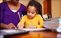 Mom helping daughter with school work