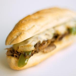 Peppered Steak Sandwiches with Caramelized Onions and Light Horseradish Sauce