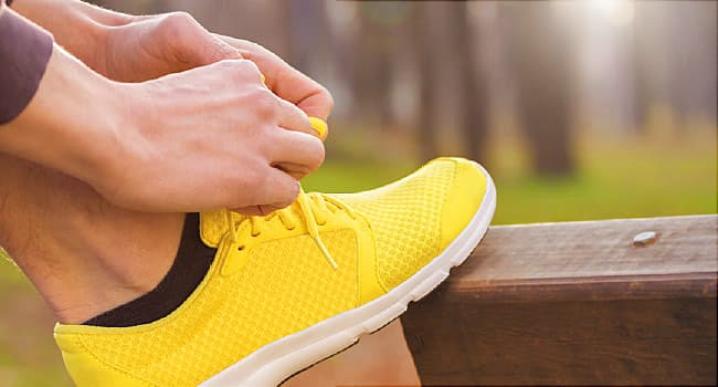 woman putting on running shoes