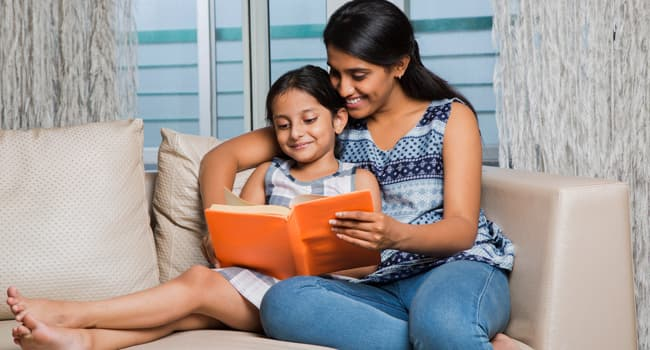 photo of mother reading to daughter