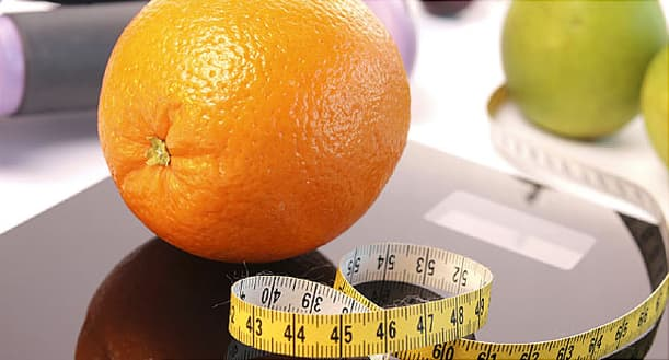 scale with fresh fruit