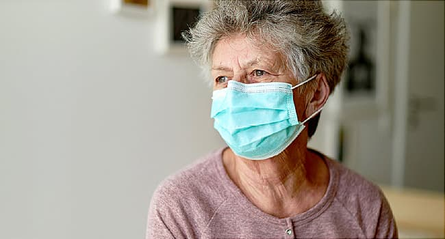 photo of mature woman wearing mask