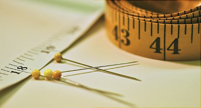 measuring tape and pins