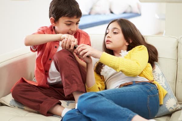 photo of brother and sister arguing over tv remote