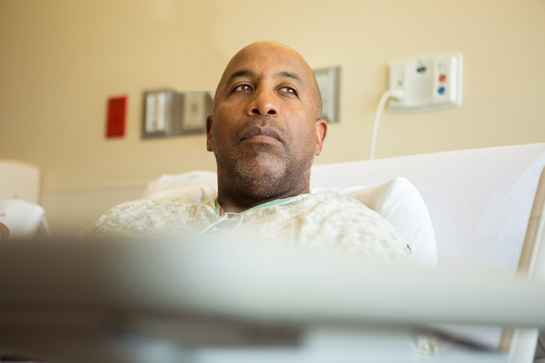 photo of man in hospital bed