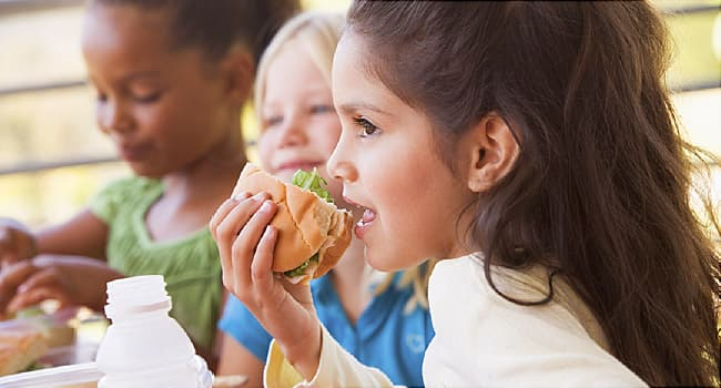 Americans are eating less healthy, except at school