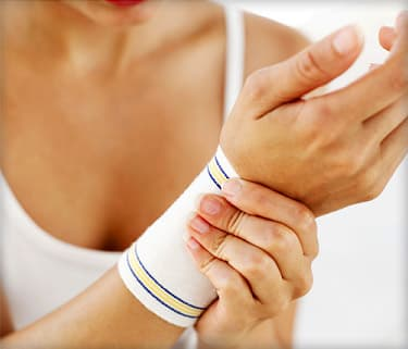 woman putting on wrist support