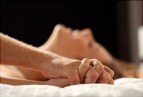 couple having sex in bed