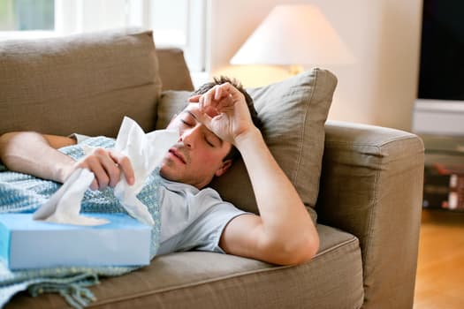 man with cold on couch