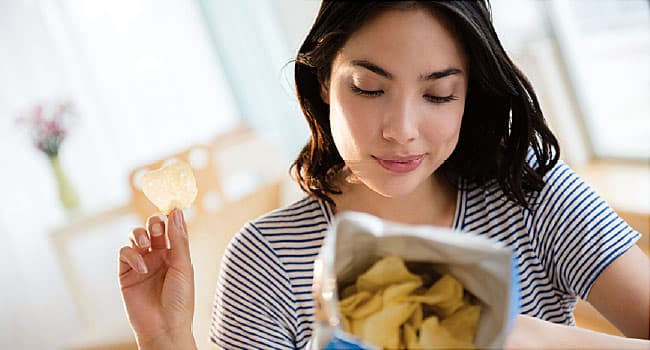 young woman reading food label