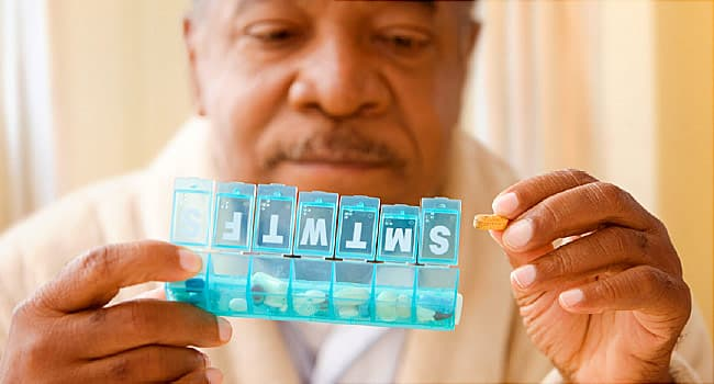man organizing pills