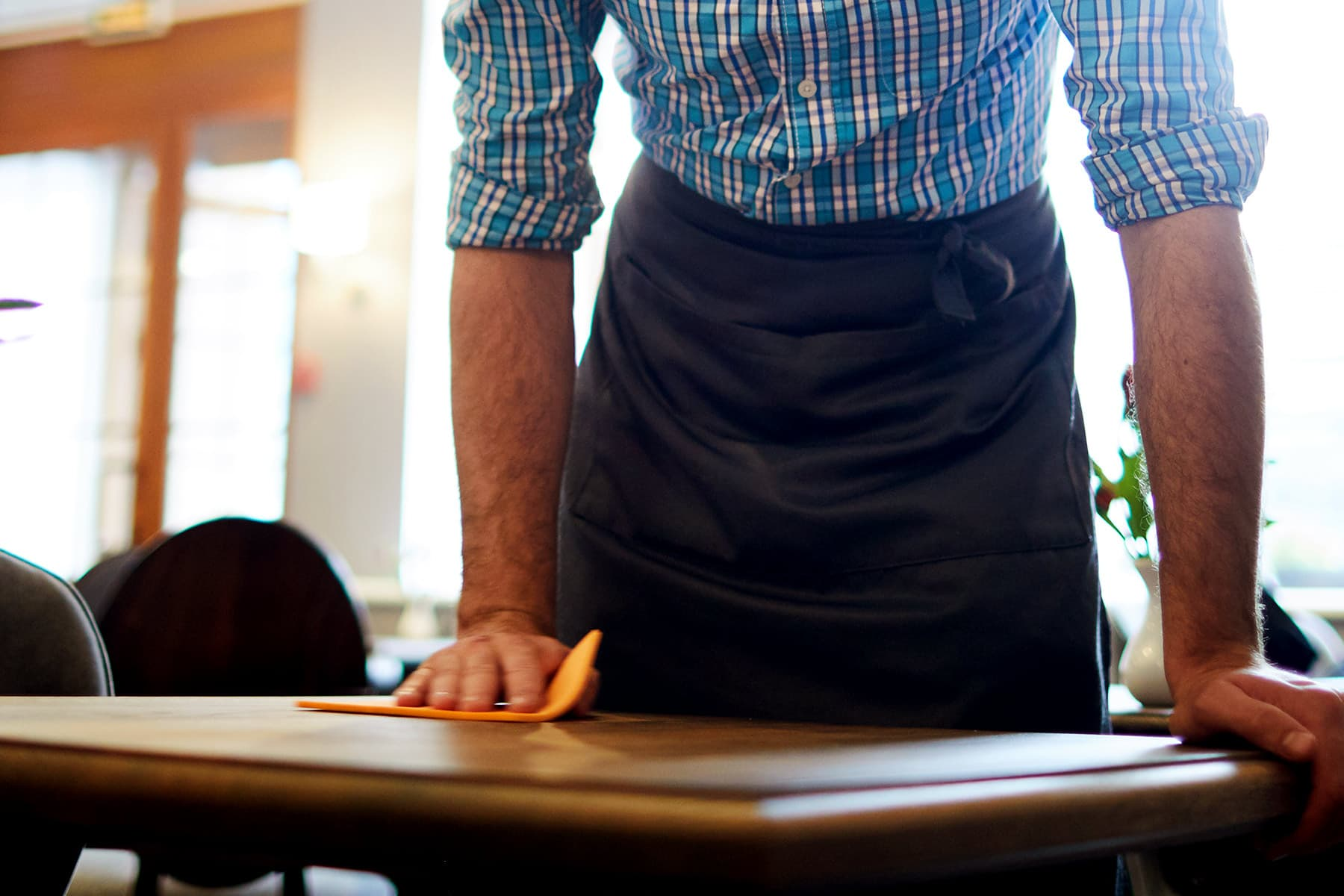 photo of waiter cleaning table