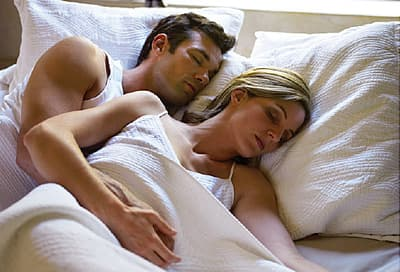 couple spooning in bed