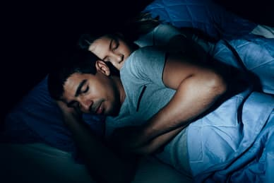 photo of couple sleeping