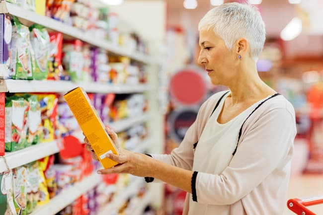 photo of person reading food label