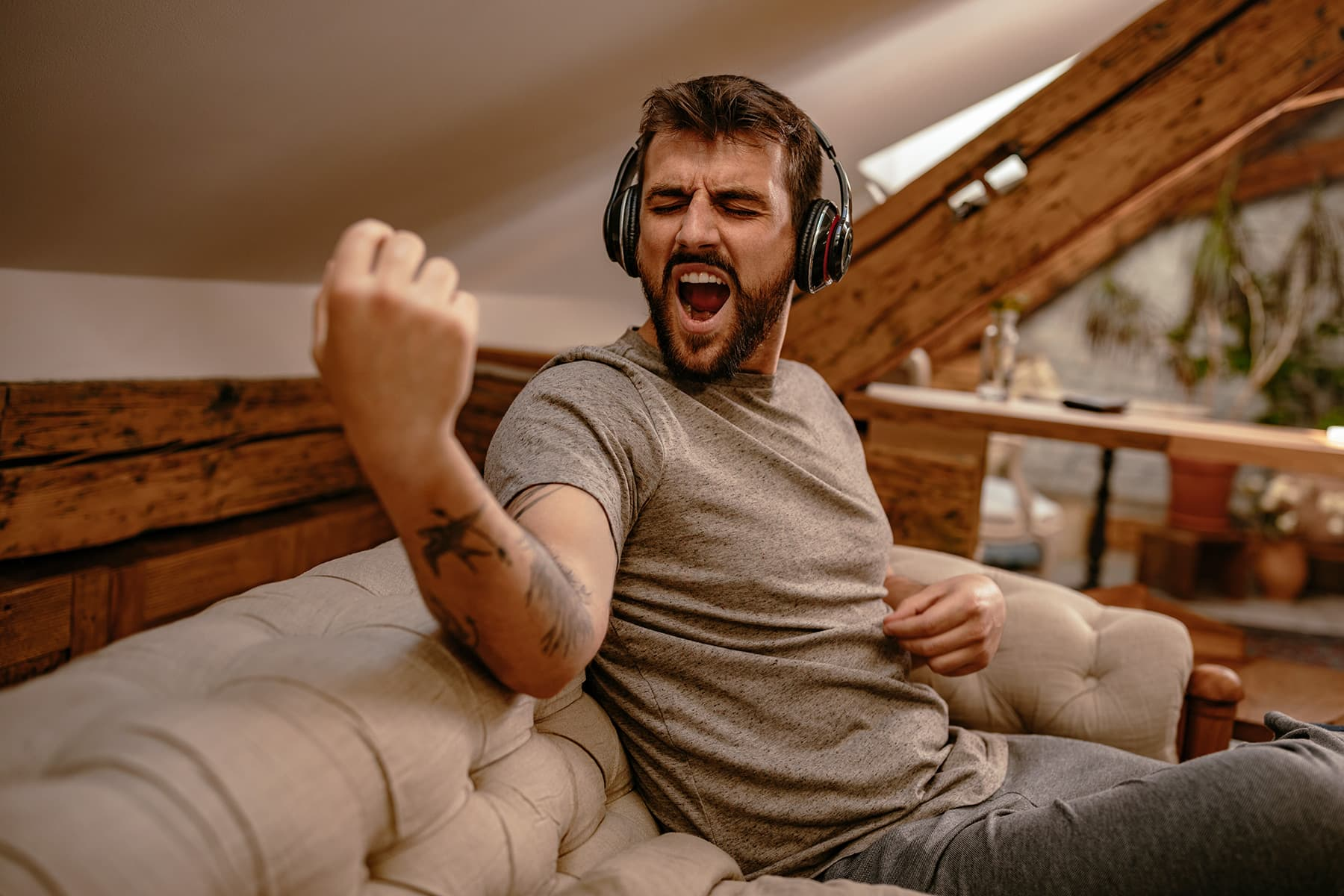 photo of man rocking out to music