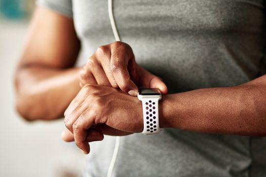 photo of man checking heart rate with smartwatch