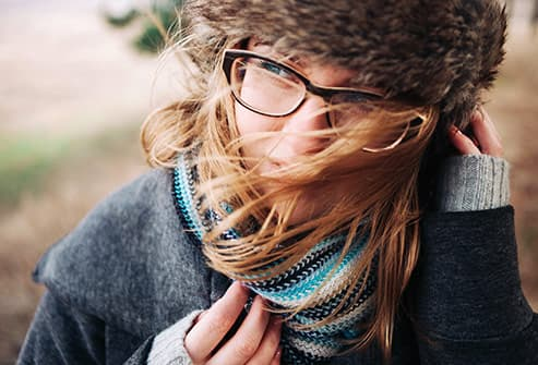 woman outside on cold windy day