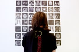 photo of woman standing in front of art