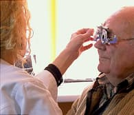 man with eye doctor