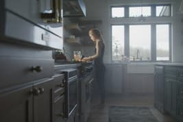 photo of depressed woman in the kitchen
