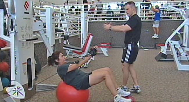 woman and trainer in gym