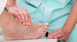 doctor inspecting patients bunion