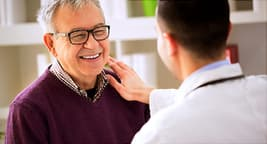 happy man talking with doctor