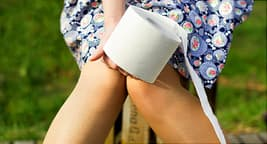 woman sitting with toilet paper