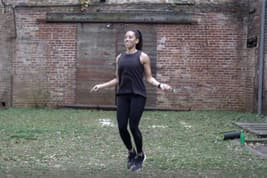 photo of woman jumping rope