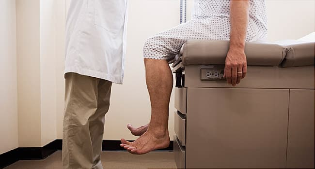 doctor with patient at medical exam table