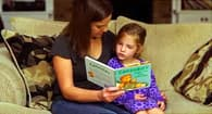 mother reading to girl