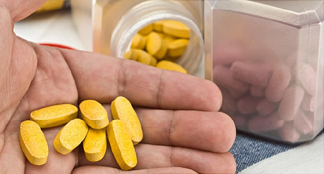 yellow pills in hand