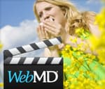 Film slate in front of woman sneezing in field