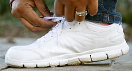 woman tying sneaker close up