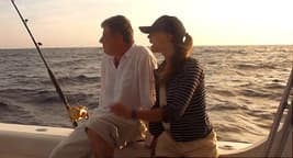 photo of couple on boat