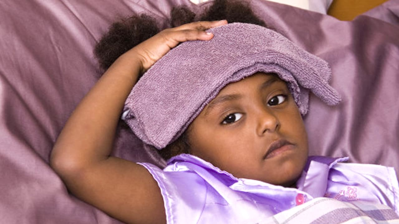 What is fever in infants and children?