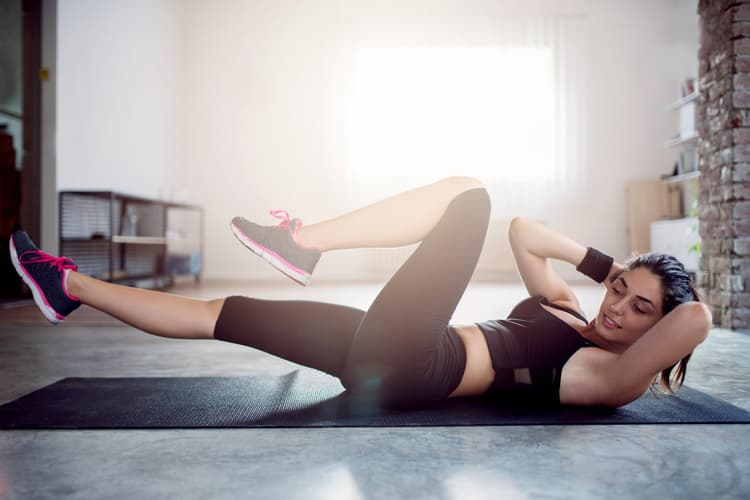 photo of woman doing crunches