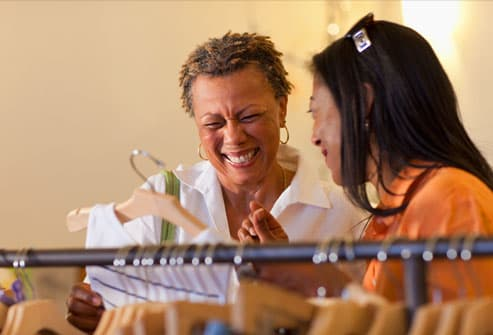 Two women having a laugh while shopping