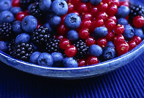 Blueberries, blackberries and currants in a bowl